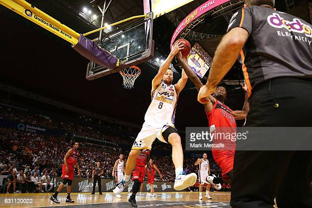 Brad Newley of the Kings and Jameel Mckay of the Willdcats compete for the ball during the round 14 NBL match between the Sydney Kings and the Perth...