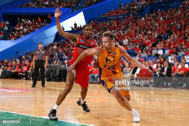 Brad Newley of the Kings drives past Bryce Cotton of the Wildcats during the round 19 NBL match between the Perth Wildcats and the Sydney Kings at...