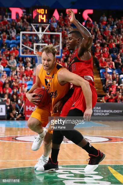 Brad Newley of the Kings drives to the basket against Casey Prather of the Wildcats during the round 19 NBL match between the Perth Wildcats and the...
