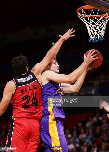 Brad Newley of the Kings drives to the basket as Cody Ellis of the Hawks defends during the round three NBL match between the Sydney Kings and the...