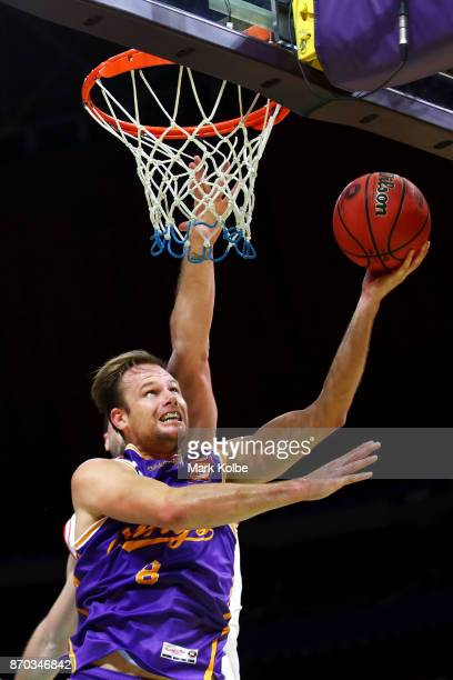 Brad Newley of the Kings drives to the basket during the round five NBL match between the Sydney Kings and the Illawarra Hawks at Qudos Bank Arena on...