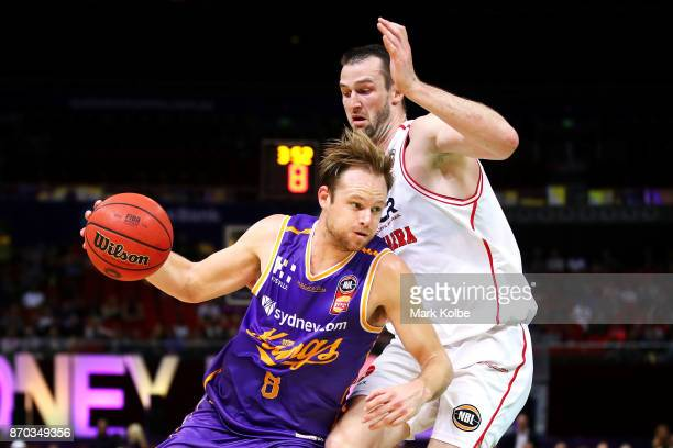 Brad Newley of the Kings drives to the basket under pressure from AJ Ogilvy of the Hawks during the round five NBL match between the Sydney Kings and...