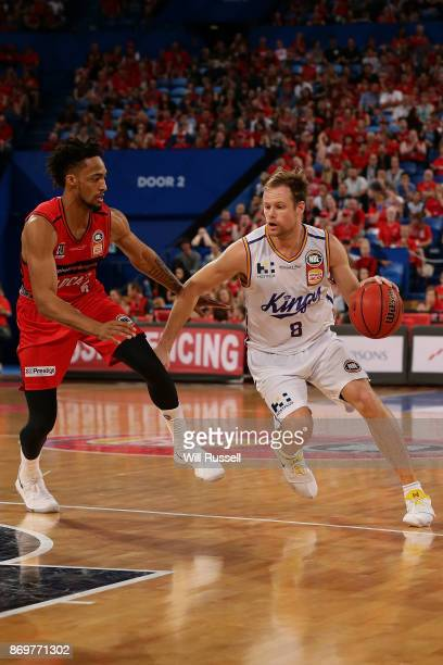 Brad Newley of the Kings gets past JeanPierre Tokoto of the Wildcats during the round five NBL match between the Perth Wildcats and the Sydney Kings...