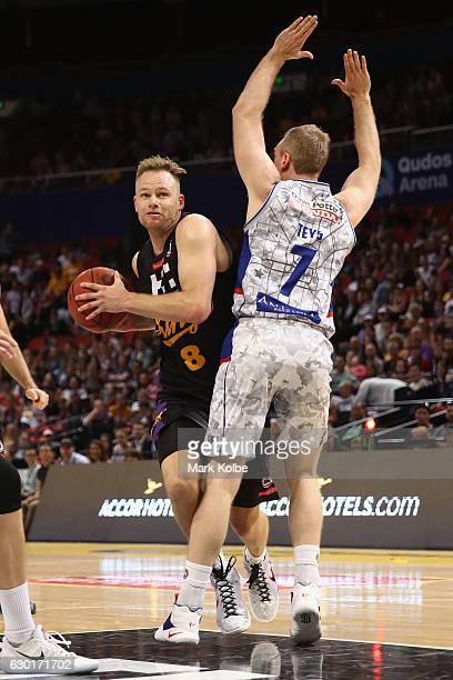 Brad Newley of the Kings is fouled by Brendan Teys of the Adelaide 36ers as he drives to the basket during the round 11 NBL match between Sydney and...