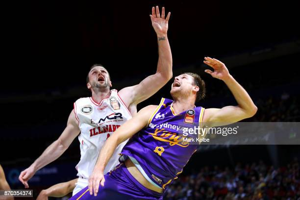 Brad Newley of the Kings lays up a shot under pressure from AJ Ogilvy of the Hawks during the round five NBL match between the Sydney Kings and the...