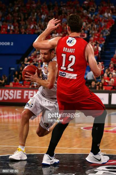 Brad Newley of the Kings looks to get past Angus Brandt of the Wildcats during the round five NBL match between the Perth Wildcats and the Sydney...