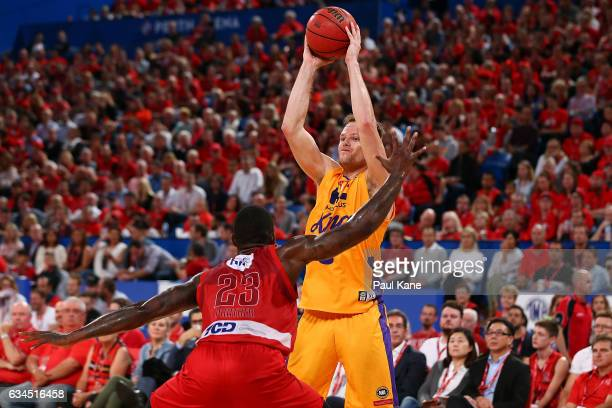 Brad Newley of the Kings looks to pass the ball against Casey Prather of the Wildcats during the round 19 NBL match between the Perth Wildcats and...