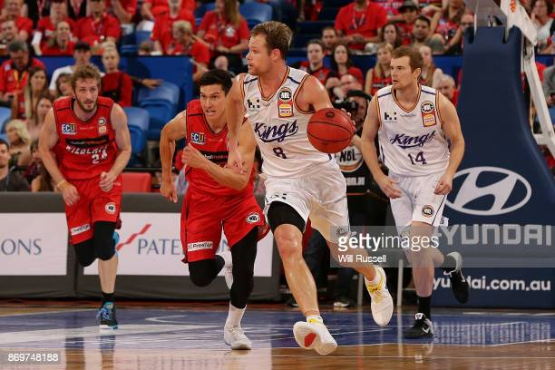 Brad Newley of the Kings looks to pass the ball during the round five NBL match between the Perth Wildcats and the Sydney Kings at Perth Arena on...