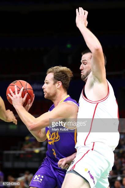 Brad Newley of the Kings looks to pass under pressure from from AJ Ogilvy of the Hawks during the round five NBL match between the Sydney Kings and...
