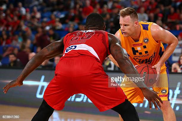 Brad Newley of the Kings looks to take on Casey Prather of the Wildcats during the round seven NBL match between the Perth Wildcats and the Sydney...