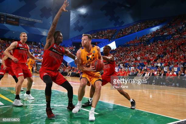 Brad Newley of the Kings works to the basket against Casey Prather of the Wildcats during the round 19 NBL match between the Perth Wildcats and the...