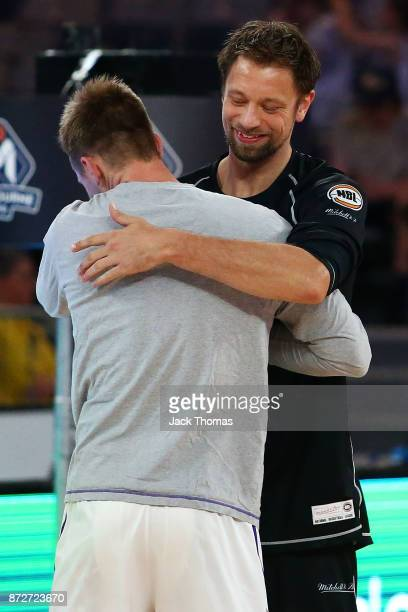 Brad Newley of the Sydney Kings and David Anderson of Melbourne United hug prior to the round six NBL match between Melbourne United and the Sydney...