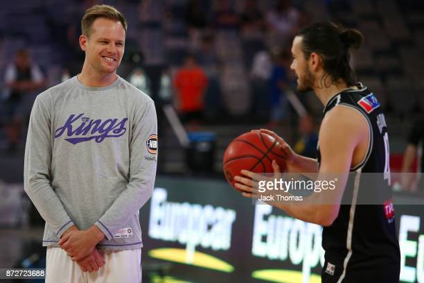 Brad Newley of the Sydney Kings Chris Goulding of Melbourne United talk prior to the round six NBL match between Melbourne United and the Sydney...
