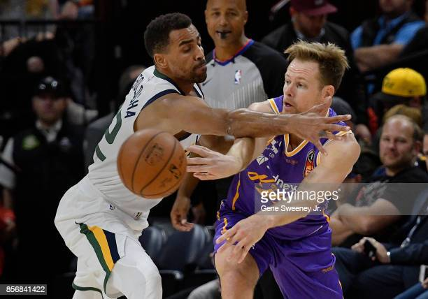 Brad Newley of the Sydney Kings passes around the defense of Thabo Sefolosha of the Utah Jazz in the first half of their preseason game at Vivint...