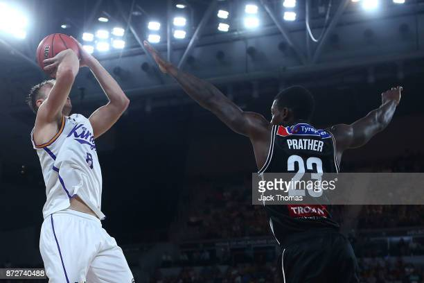 Brad Newley of the Sydney Kings shoots over Casey Prather of Melbourne United during the round six NBL match between Melbourne United and the Sydney...