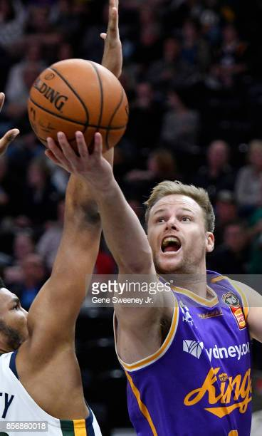 Brad Newley of the Sydney Kings tries for the basket past the defense of Tony Bradley of the Utah Jazz in the second half of the Kings 10883...