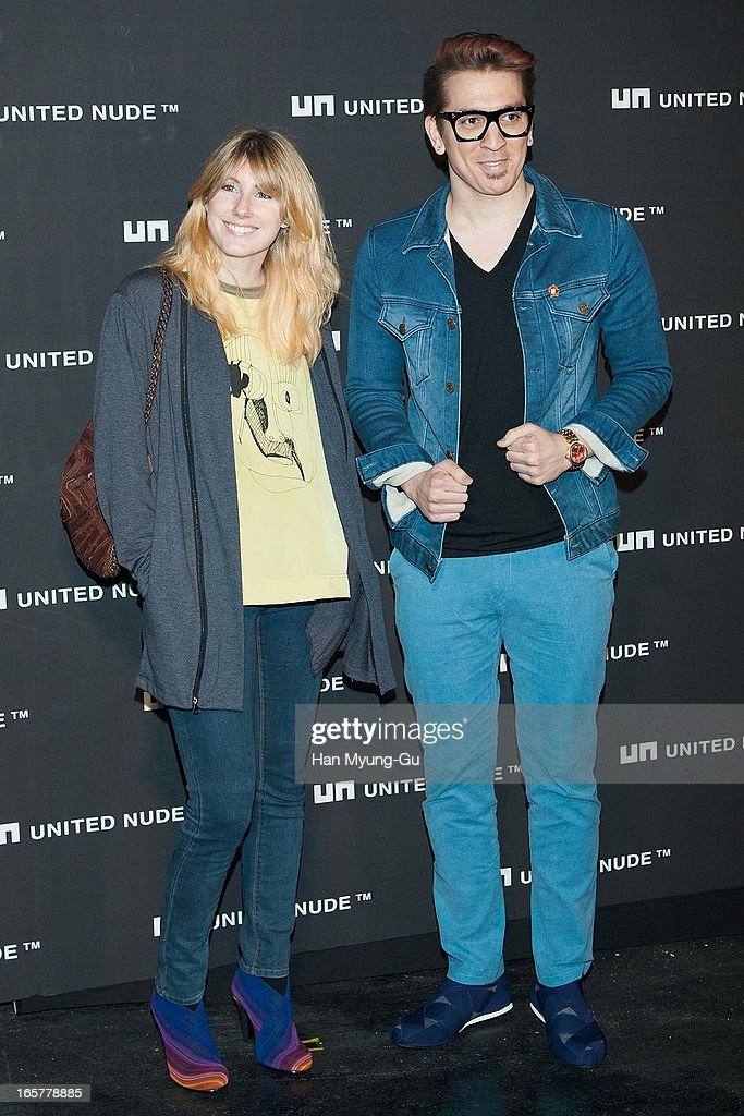 Brad (R) of boy band Busker Busker and his wife pose for media the 'United Nude' flagship store opening at United Nude Gangnam Store on April 5, 2013 in Seoul, South Korea.