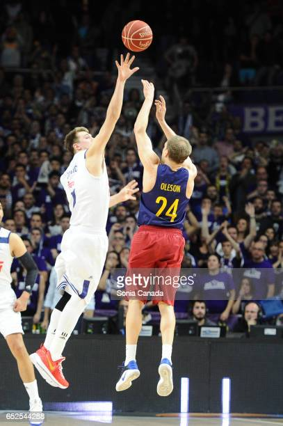 Brad Oleson #24 guard of FC Barcelona and Luka Doncic #7 guard of Real Madrid during the Liga Endesa game between Real Madrid v FC Barcelona at...