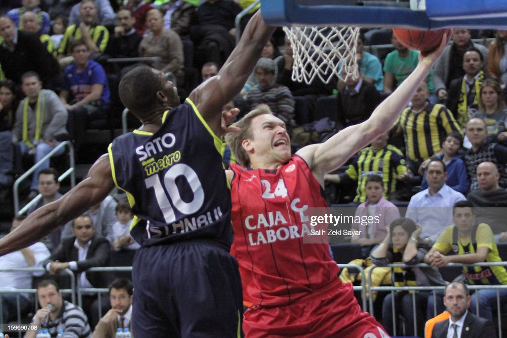 Brad Oleson #24 of Caja Laboral competes with Romain Sato #10 of Fenerbahce Ulker during the 2012-2013 Turkish Airlines Euroleague Top 16 Date 4 between Fenerbahce Ulker Istanbul v Caja Laboral Vitoria at Fenerbahce Ulker Sports Arena on January 18, 2013 in Istanbul, Turkey.