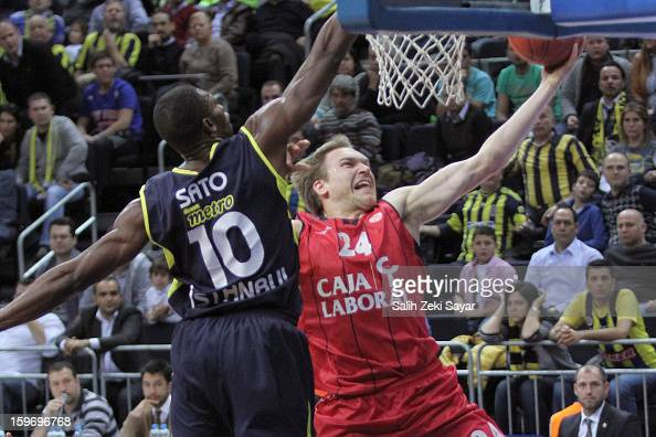 Brad Oleson of Caja Laboral competes with Romain Sato of Fenerbahce Ulker during the 20122013 Turkish Airlines Euroleague Top 16 Date 4 between...