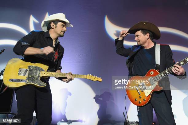 Brad Paisley and Brad Paisley perform on stage at A Funny Thing Happened On The Way To Cure Parkinson's benefitting The Michael J Fox Foundation at...