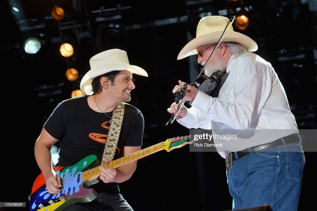 <a gi-track='captionPersonalityLinkClicked' href=/galleries/search?phrase=Brad+Paisley&family=editorial&specificpeople=206616 ng-click='$event.stopPropagation()'>Brad Paisley</a> and Charlie Daniels perform during the 2013 CMA Music Festival on June 9, 2013 in Nashville, Tennessee.