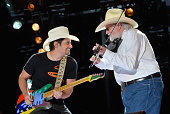 Brad Paisley and Charlie Daniels perform during the 2013 CMA Music Festival on June 9 2013 in Nashville Tennessee