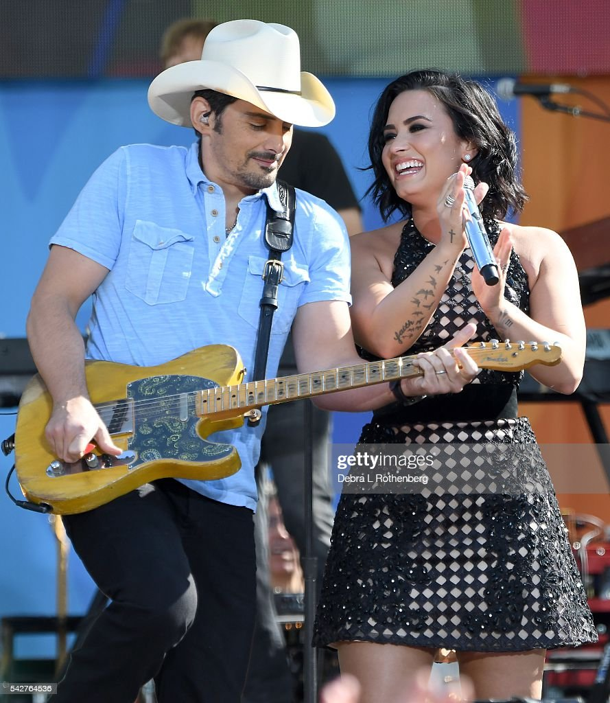 Brad Paisley and Demi Lovato perform live on ABC's 'Good Morning America' at Summer Stage at Rumsey Playfield Central Park on June 24 2016 in New...