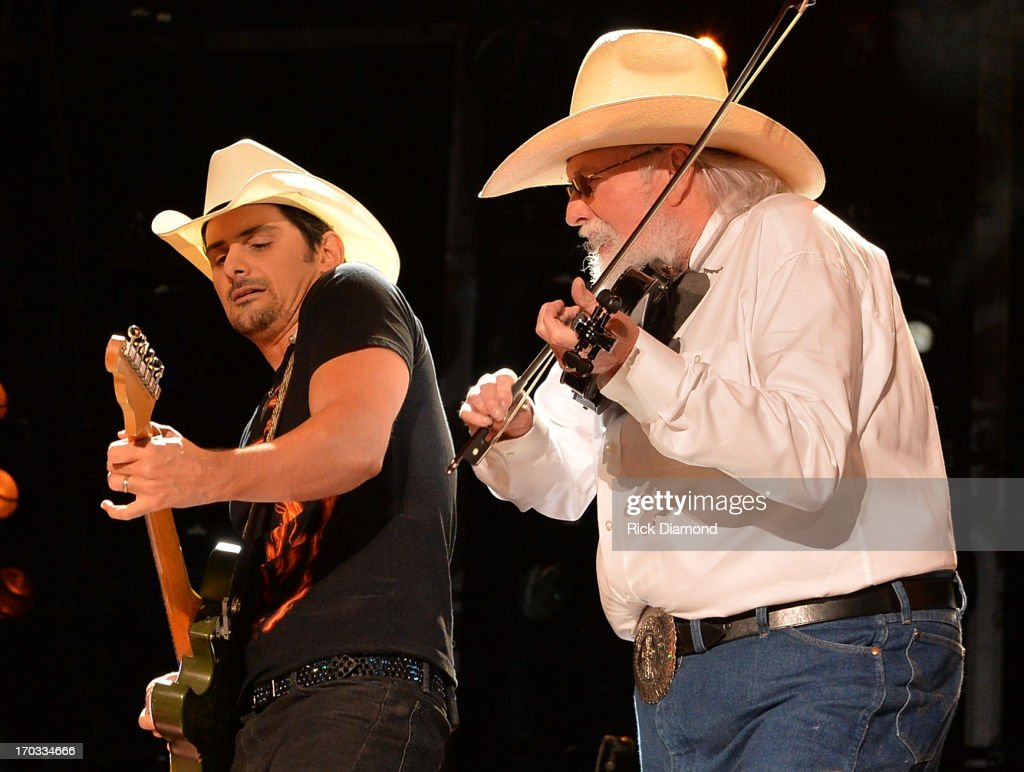 Brad Paisley is joined on stage by Charlie Daniels during the 2013 CMA Music Festival on June 9, 2013 in Nashville, Tennessee.