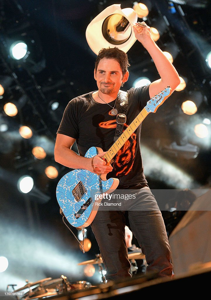<a gi-track='captionPersonalityLinkClicked' href=/galleries/search?phrase=Brad+Paisley&family=editorial&specificpeople=206616 ng-click='$event.stopPropagation()'>Brad Paisley</a> performs during the 2013 CMA Music Festival on June 9, 2013 in Nashville, Tennessee.