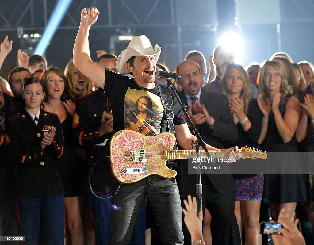 <a gi-track='captionPersonalityLinkClicked' href=/galleries/search?phrase=Brad+Paisley&family=editorial&specificpeople=206616 ng-click='$event.stopPropagation()'>Brad Paisley</a> performs onstage during the 47th annual CMA Awards at the Bridgestone Arena on November 6, 2013 in Nashville, Tennessee.
