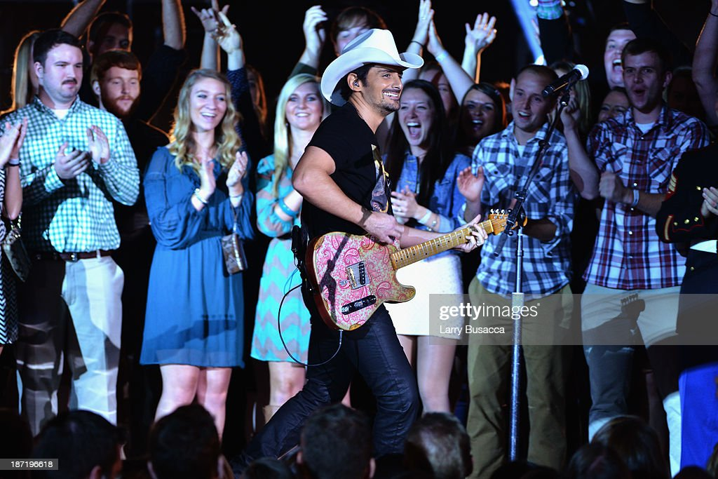Brad Paisley performs onstage during the 47th annual CMA awards at the Bridgestone Arena on November 6, 2013 in Nashville, United States.