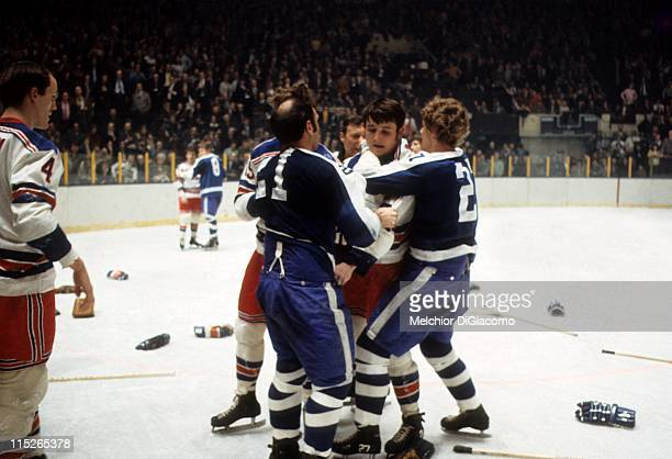 Brad Park and Dale Rolfe of the New York Rangers wrestle with Darryl Sittler and Bob Baun of the Toronto Maple Leafs during their game circa 1972 at...