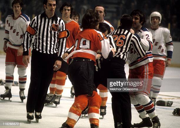 Brad Park of the New York Rangers argues with Rick MacLeish of the Philadelphia Flyers as the linesman keep them separated during their game circa...