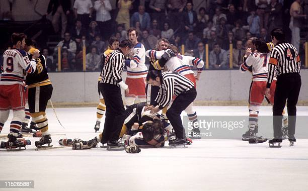 Brad Park of the New York Rangers fights with Bobby Orr of the Boston Bruins during their game circa 1973 at the Madison Square Garden in New York...