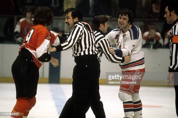 Brad Park of the New York Rangers looks to fight Rick MacLeish of the Philadelphia Flyers during their game circa 1974 at the Madison Square Garden...