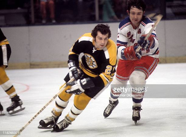 Brad Park of the New York Rangers looks to slash Don Marcotte of the Boston Bruins during their game circa 1972 at the Madison Square Garden in New...
