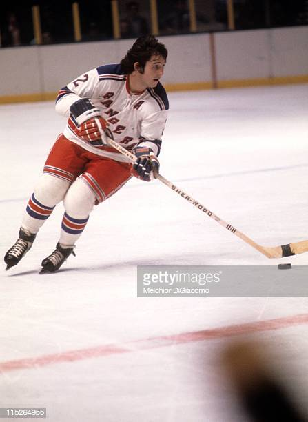 Brad Park of the New York Rangers skates with the puck during an NHL game circa 1975 at the Madison Square Garden in New York New York