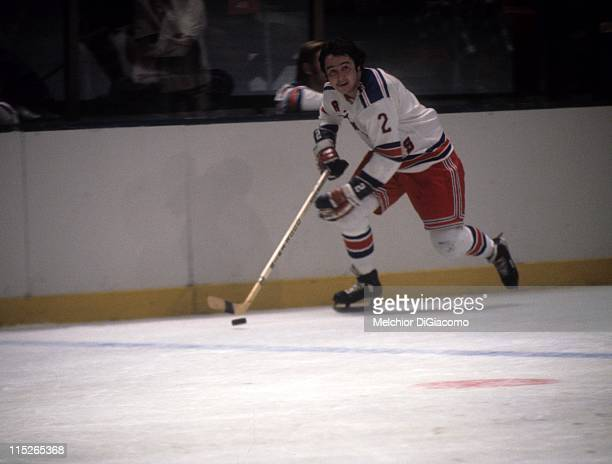 Brad Park of the New York Rangers skates with the puck during an NHL game circa 1974 at the Madison Square Garden in New York New York