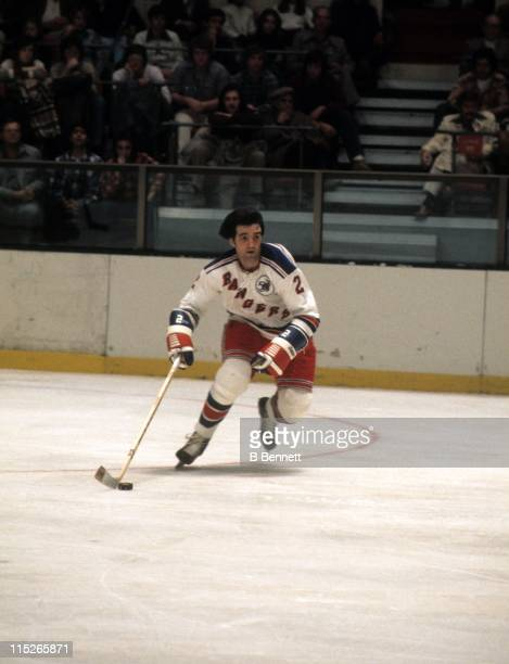 Brad Park of the New York Rangers skates with the puck during an NHL game in November 1975 at the Madison Square Garden in New York New York