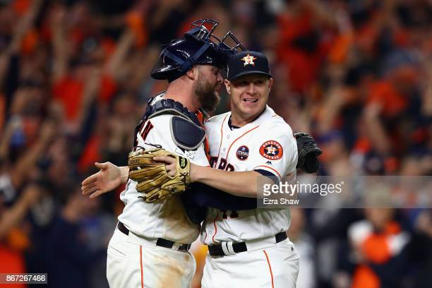 Brad Peacock and Brian McCann of the Houston Astros celebrate after defeating the Los Angeles Dodgers in game three of the 2017 World Series at...