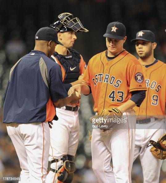 Brad Peacock of the Houston Astros hands the ball to manager Bo Porter of the Houston Astros as he is taken out of the game in hte fifth inning...