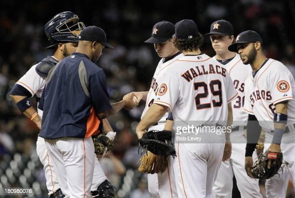 Brad Peacock of the Houston Astros hands the ball to manager Bo Porter of the Houston Astros as Brett Wallace Jonathan Villar and Matt Dominguez lok...