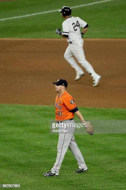 Brad Peacock of the Houston Astros looks on as Gary Sanchez of the New York Yankees rounds the bases after a solo home run during the seventh inning...