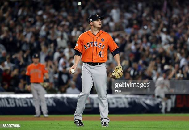 Brad Peacock of the Houston Astros reacts after allowing a solo home run during the seventh inning against Gary Sanchez of the New York Yankees in...