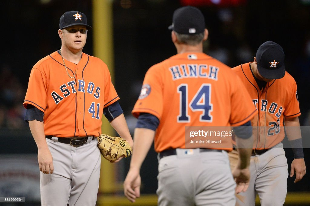 Brad Peacock #41 of the Houston Astros reacts as manager A.J. Hinch #14 makes his way to the mound to relieve him in the fifth inning against the Arizona Diamondbacks at Chase Field on August 15, 2017 in Phoenix, Arizona.