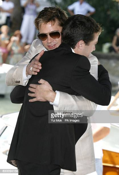 Brad Pitt amd Casey Affleck embrace during a photocall for the film The Assassination of Jesse James by the Coward Robert Ford