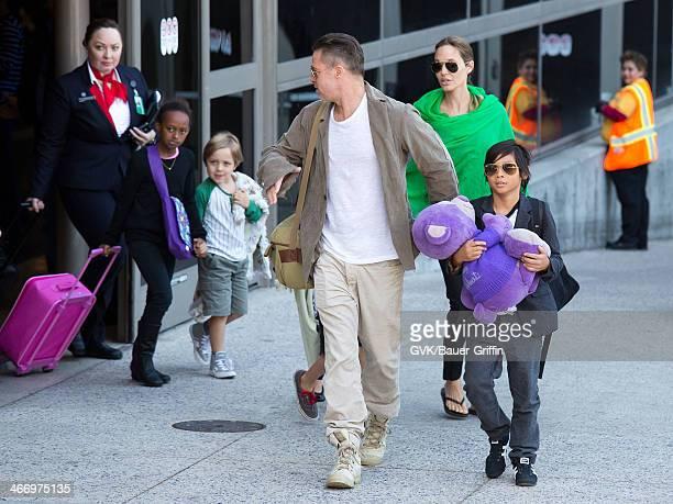 Brad Pitt and Angelina Jolie are seen after landing at Los Angeles International Airport with their children Pax JoliePitt Shiloh JoliePitt Zahara...