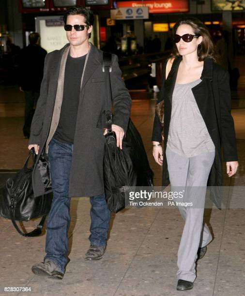Brad Pitt and Angelina Jolie at Heathrow Airport where they are due to leave the UK on a flight to Zurich Wednesday January 25 2006 PRESS ASSOCIATION...