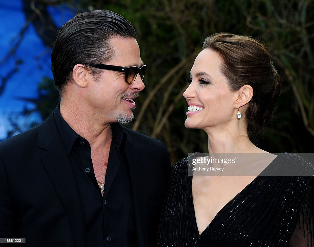 <a gi-track='captionPersonalityLinkClicked' href=/galleries/search?phrase=Brad+Pitt+-+Actor&family=editorial&specificpeople=201682 ng-click='$event.stopPropagation()'>Brad Pitt</a> and <a gi-track='captionPersonalityLinkClicked' href=/galleries/search?phrase=Angelina+Jolie&family=editorial&specificpeople=201591 ng-click='$event.stopPropagation()'>Angelina Jolie</a> attend a private reception as costumes and props from Disney's 'Maleficent' are exhibited in support of Great Ormond Street Hospital at Kensington Palace on May 8, 2014 in London, England.